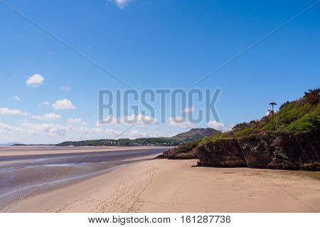 Beach at low tide at Portmeirion Gwynedd Wales looking towards Porthmadog and Tremadog Bay.