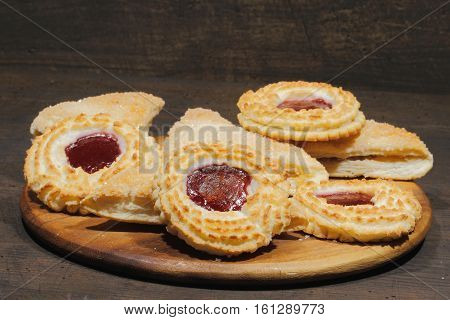 With apple stuffed dumplings and coconut tartlets on a rustic wooden surface