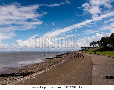 Seafront and dramatic sky and clouds in the Solway Firth at Silloth in Cumbria.