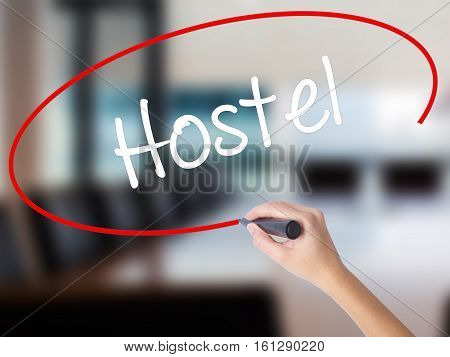 Woman Hand Writing Hostel With A Marker Over Transparent Board