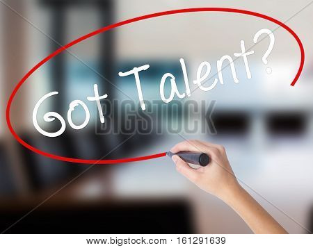 Woman Hand Writing Got Talent? With A Marker Over Transparent Board