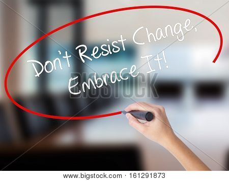 Woman Hand Writing Don't Resist Change, Embrace It! With A Marker Over Transparent Board