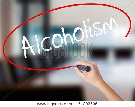 Woman Hand Writing Alcoholism With A Marker Over Transparent Board.