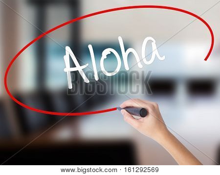 Woman Hand Writing Aloha  With A Marker Over Transparent Board
