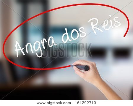 Woman Hand Writing Angra Dos Reis With A Marker Over Transparent Board