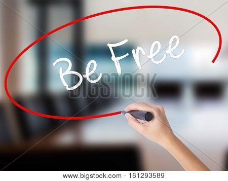 Woman Hand Writing Be Free With A Marker Over Transparent Board
