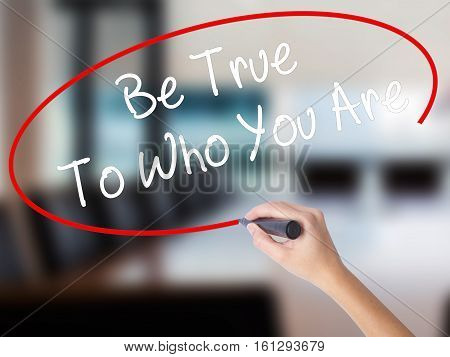 Woman Hand Writing Be True To Who You Are With A Marker Over Transparent Board
