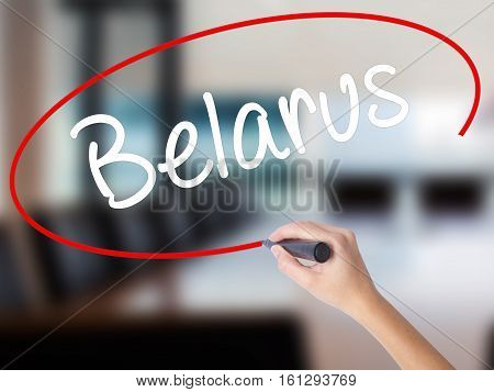 Woman Hand Writing Belarus  With A Marker Over Transparent Board.