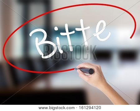 Woman Hand Writing Bitte (please In German) With A Marker Over Transparent Board