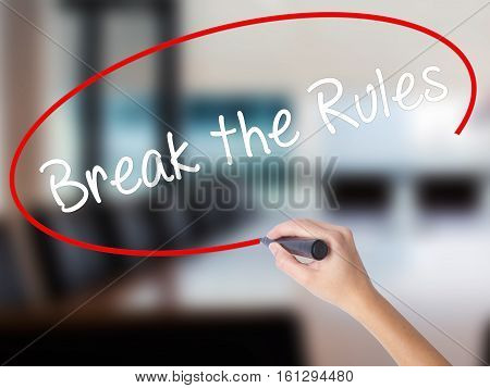 Woman Hand Writing Break The Rules With A Marker Over Transparent Board