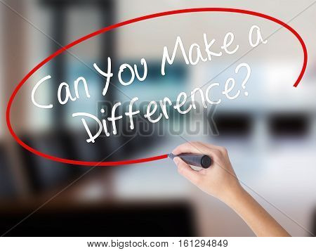 Woman Hand Writing Can You Make A Difference? With A Marker Over Transparent Board.