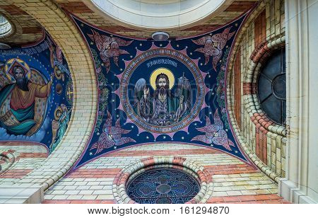 Sibiu Romania - July 7 2016: Paintings above main entrance of Orthodox Holy Trinity Cathedral in Sibiu city