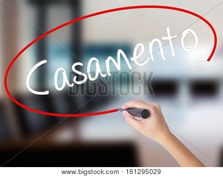 Woman Hand Writing Casamento (wedding In Portuguese) With A Marker Over Transparent Board