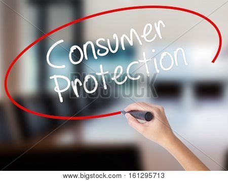 Woman Hand Writing Consumer Protection With A Marker Over Transparent Board.