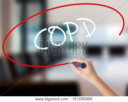 Woman Hand Writing Copd With A Marker Over Transparent Board