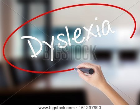 Woman Hand Writing Dyslexia With A Marker Over Transparent Board