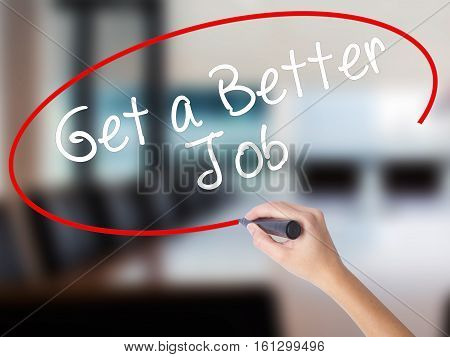 Woman Hand Writing Get A Better Job  With A Marker Over Transparent Board