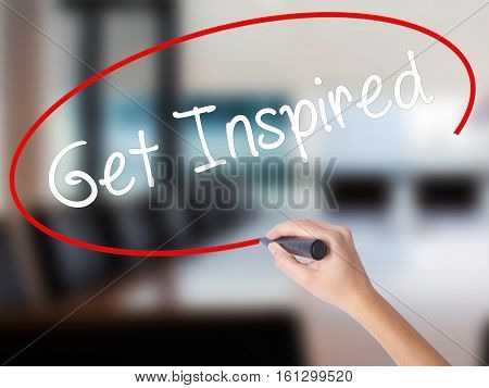 Woman Hand Writing Get Inspired With A Marker Over Transparent Board