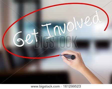 Woman Hand Writing Get Involved With A Marker Over Transparent Board