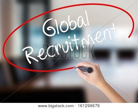 Woman Hand Writing Global Recruitment With A Marker Over Transparent Board
