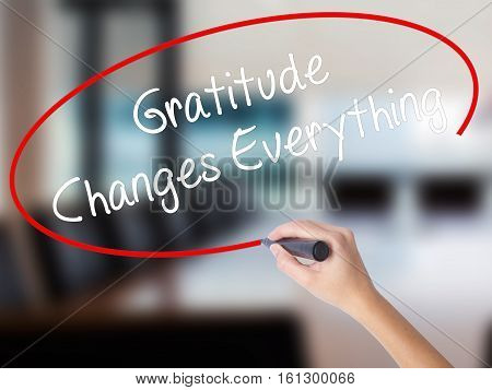 Woman Hand Writing Gratitude Changes Everything With A Marker Over Transparent Board