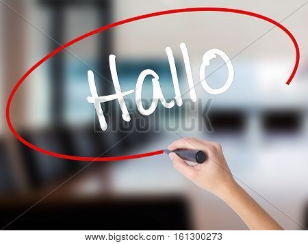 Woman Hand Writing Hallo  (hello In German) With A Marker Over Transparent Board
