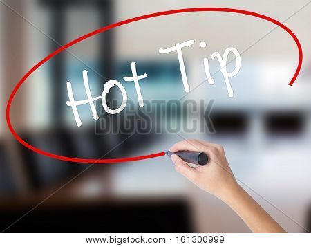 Woman Hand Writing Hot Tip With A Marker Over Transparent Board.