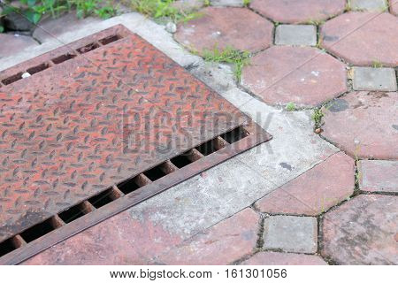 steel lid old water drain or ditch on the road