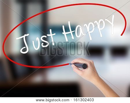 Woman Hand Writing Just Happy With A Marker Over Transparent Board