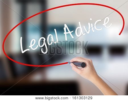 Woman Hand Writing Legal Advice With A Marker Over Transparent Board