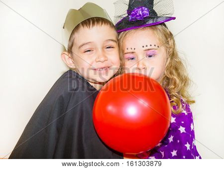 Two funny kids wearing devil and vampire costume on halloween
