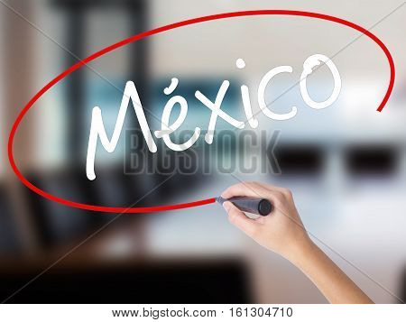 Woman Hand Writing Mexico (in Spanish) With A Marker Over Transparent Board.
