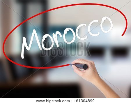 Woman Hand Writing Morocco  With A Marker Over Transparent Board