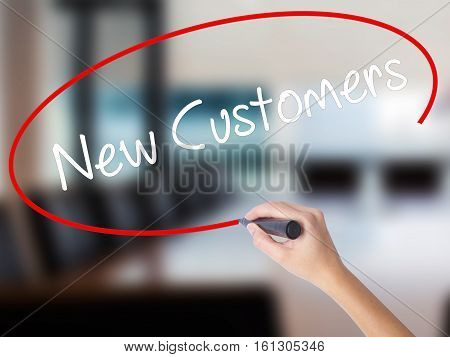 Woman Hand Writing  New Customers With A Marker Over Transparent Board