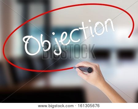 Woman Hand Writing Objection With A Marker Over Transparent Board