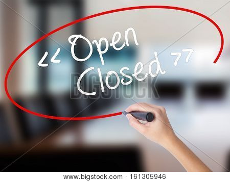 Woman Hand Writing Open - Closed With A Marker Over Transparent Board