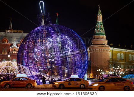 MOSCOW, RUSSIA - JAN 13, 2016: Big fishnet Christmas ball at Manege Square during New Year holidays in the evening. Manege Square situated near the Kremlin and the Alexander Garden.