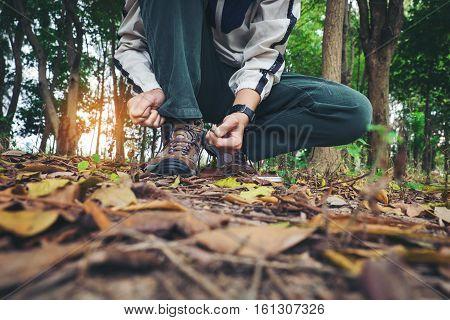 Traveler Man Hands Lacing Up Trekking Shoes