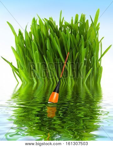 Fishing float in the water against the background of green grass