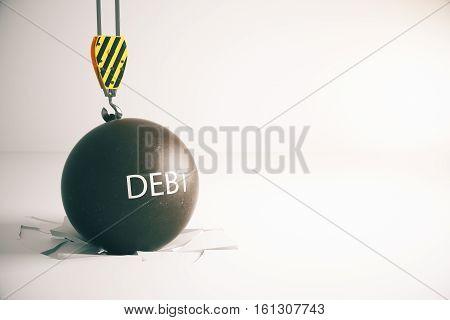 Debt concept. Wrecking ball with text in concrete interior with broken floor. 3D Rendering