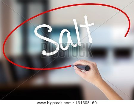 Woman Hand Writing Salt With A Marker Over Transparent Board