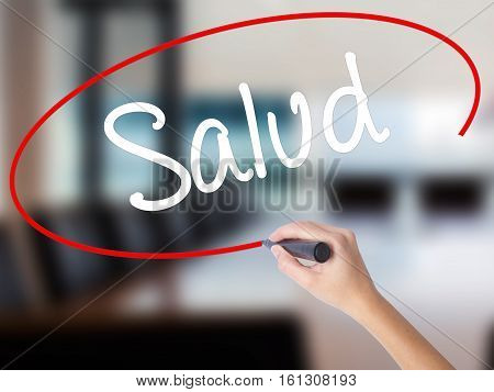 Woman Hand Writing Salud (health In Spanish) With A Marker Over Transparent Board.