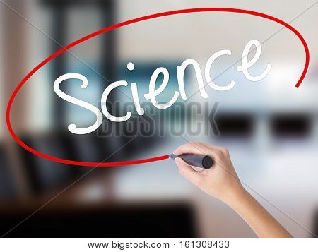 Woman Hand Writing Science With A Marker Over Transparent Board