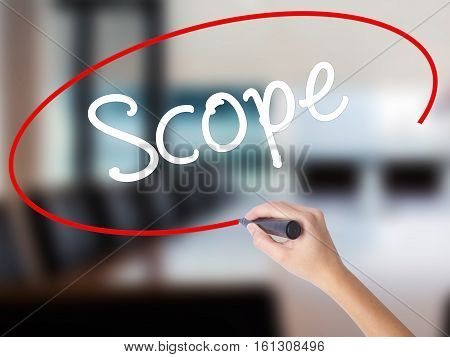 Woman Hand Writing Scope With A Marker Over Transparent Board
