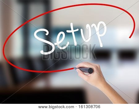 Woman Hand Writing Setup  With A Marker Over Transparent Board