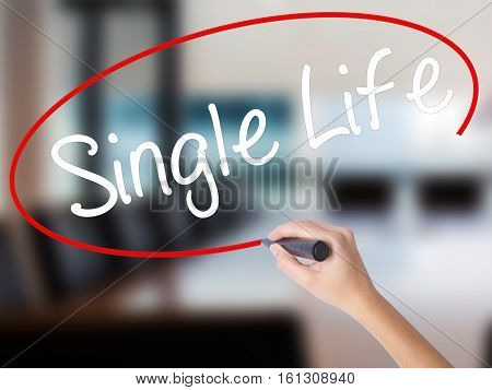 Woman Hand Writing Single Life With A Marker Over Transparent Board