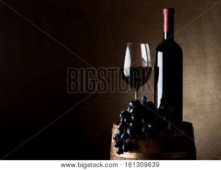 Juicy grape and wine with barrel on canvas