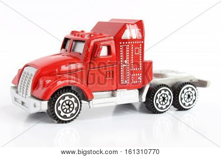 Isolated red toy truck side view macro photography