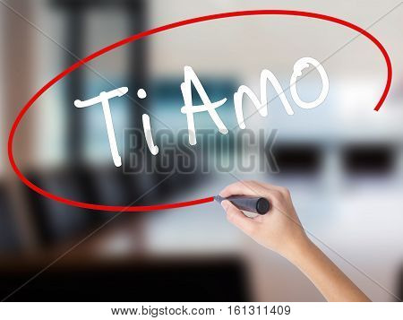 Woman Hand Writing Ti Amo (i Love You In Italian) With A Marker Over Transparent Board.