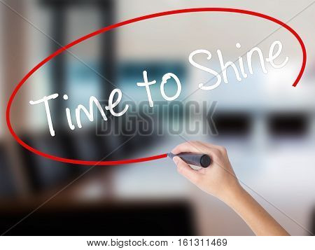 Woman Hand Writing Time To Shine With A Marker Over Transparent Board